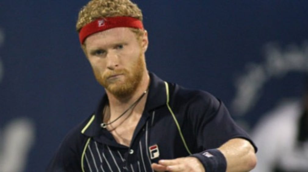 The Russian will defend his title against Gilles Simon after beating top seed James Blake in three sets...