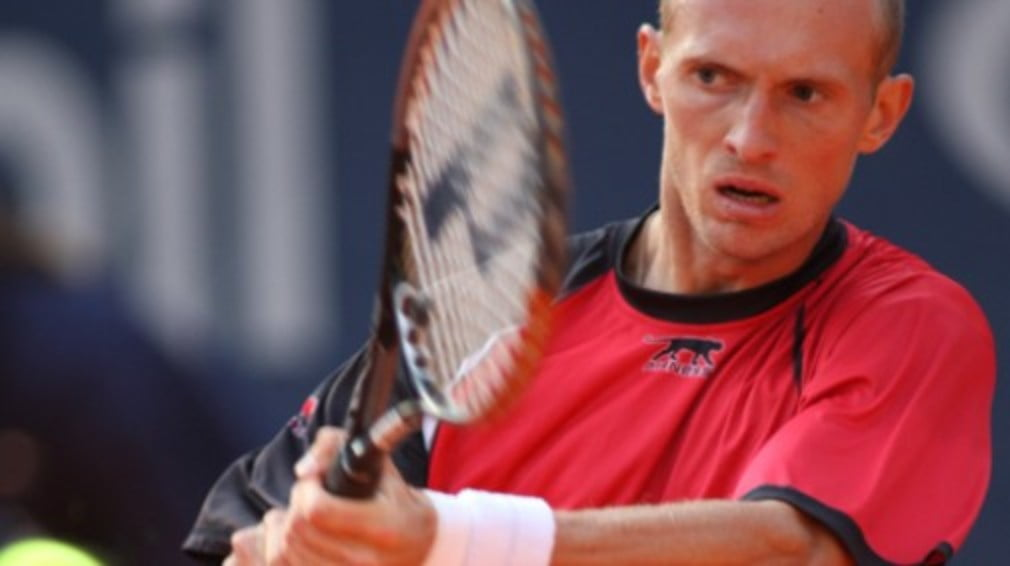Nikolay Davydenko's hopes of a Masters Cup place took a knock when he lost in the second round in Madrid on Wednesday.