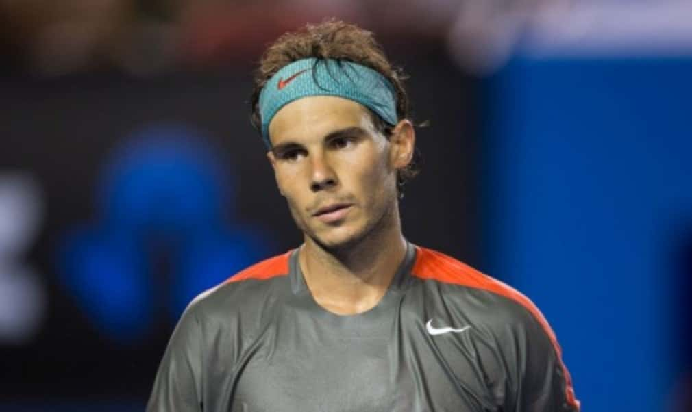 Rafael Nadal admits he has not fully recovered from a back injury but has no regrets about playing at the Rio Open