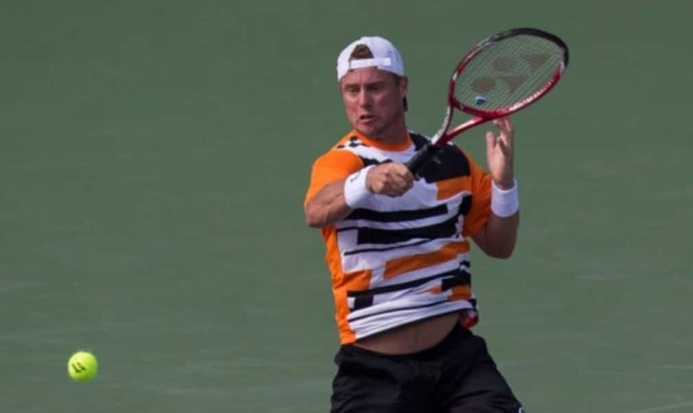 Lleyton Hewitt claimed his 600th match win at the Sony Open as he set up a second-round clash with Rafael Nadal in Miami