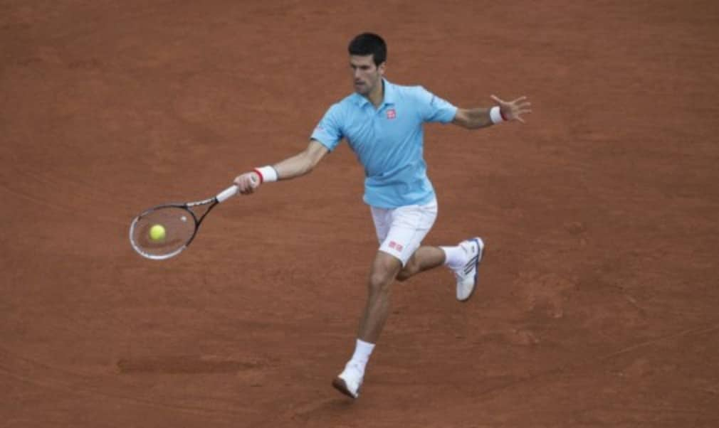 Novak Djokovic swept past French hope Jo-Wilfried Tsonga 6-1 6-4 6-1 in just 89 minutes to reach his 20th straight Grand Slam quarter-final