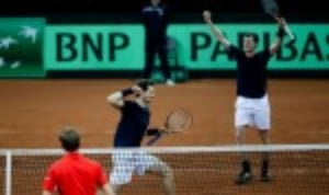 Andy and Jamie Murray defeated David Goffin and Steve Darcis 6-4 4-6 6-3 6-2 to give GB a 2-1 lead heading into SundayŠ—Ès reverse singles