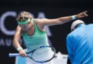 Victoria Azarenka celebrates reaching the Australian Open third round after a 6-1 6-2 victory over Danka Kovinic