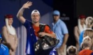 Lleyton Hewitt bade an emotional farewell to tennis as he bowed out following his final professional singles match at the Australian Open