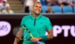 Jo-Wilfried Tsonga grins after beating Pierre-Hugues Herbert to reach the Australian Open last 16