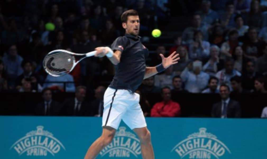 Novak Djokovic needed three sets to beat Dominic Thiem in his opening match at the Barclays ATP World Tour Finals in London on Sunday