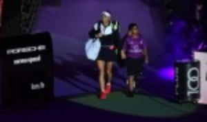 Caroline Wozniacki eased into the semi-finals of the BNP Paribas WTA Finals in Singapore after a thumping 6-0 6-2 win over Simona Halep in the Red Group