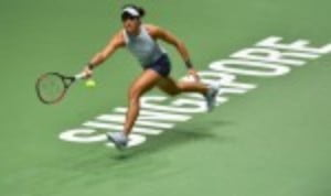 Caroline Garcia has emerged as the surprise winner of the Red Group at the BNP Paribas WTA Finals in Singapore