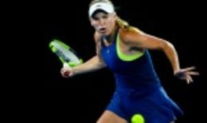 Caroline Wozniacki sailed into the third round of the Qatar Open after an emphatic 6-2 6-0 win over Carina Witthoeft in just 57 minutes
