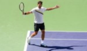 Roger Federer displayed his battling qualities as he recovered from a precarious position to defeat Borna Coric 5-7 6-4 6-4 and reach an eighth final at the BNP Paribas Open