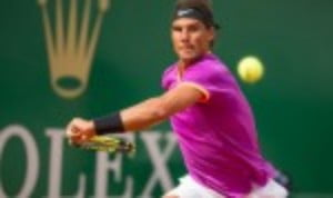 Rafael Nadal eased into a 12th final at the Rolex Monte-Carlo Masters with a 6-4 6-1 success over Grigor Dimitrov
