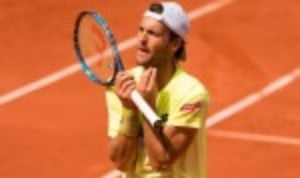 Joao SousaŠ—Ès bid to become the first Portuguese winner of the Estoril Open remains on track after a topsy-turvy 6-3 1-6 6-0 win over Kyle Edmund
