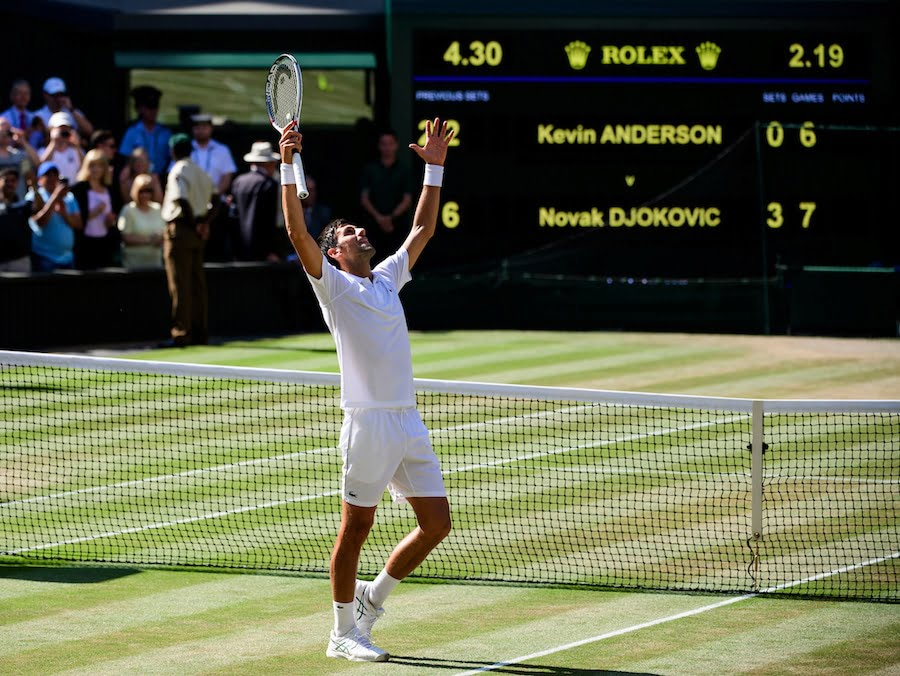 Novak Djokovic celebrates after winning Wimbledon 2018