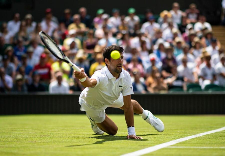 Novak Djokovic Wimbledon 2019 diving for shot