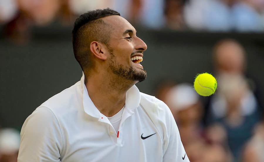 Nick Kyrgios laughs