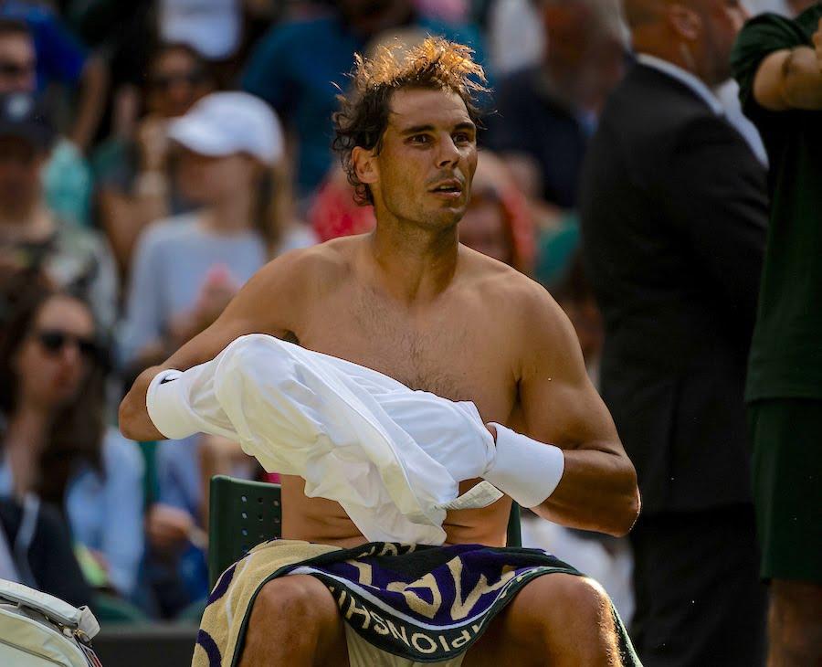 Topless Rafa Nadal changes shirt at Wimbledon