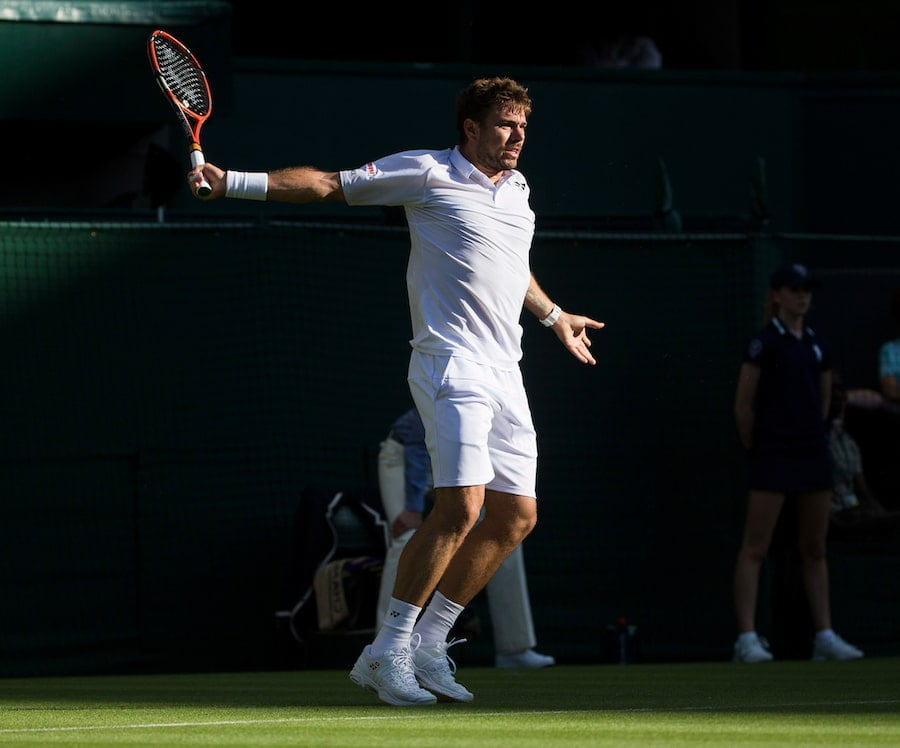 Stan Wawrinka hits backhand on grass at Wimbledon