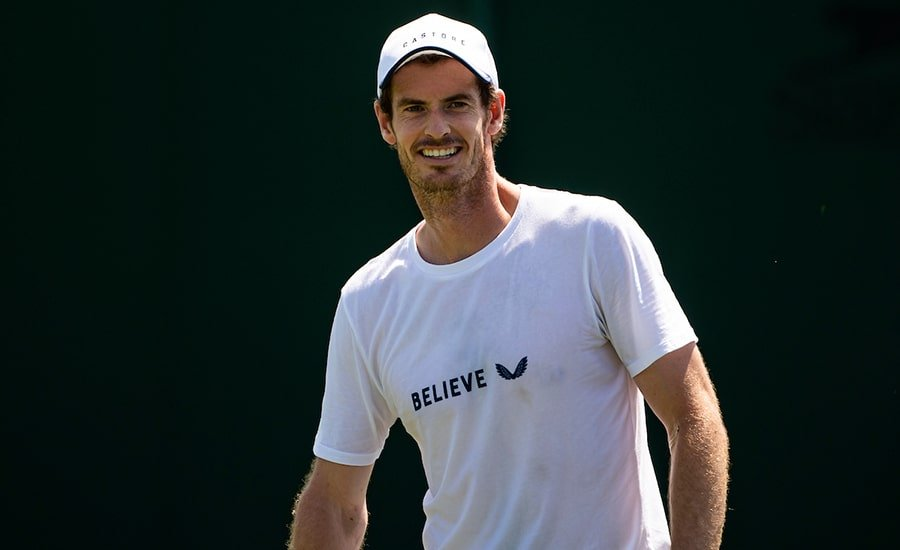 Andy Murray smiling in practice