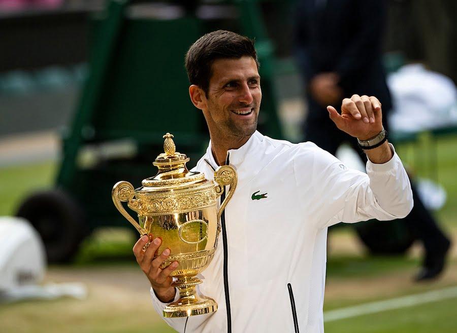 Novak Djokovic Wimbledon trophy after beating Roger Federer
