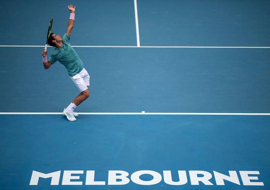 Jaume Munar serves at Australian Open 2019