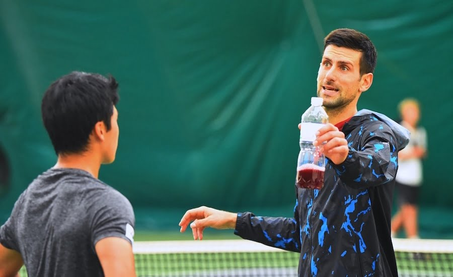 Novak Djokovic chats at Mouratgolou Academy