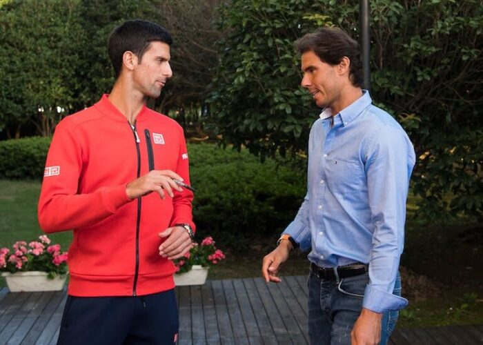 Novak Djokovic chats with Rafael Nadal off court