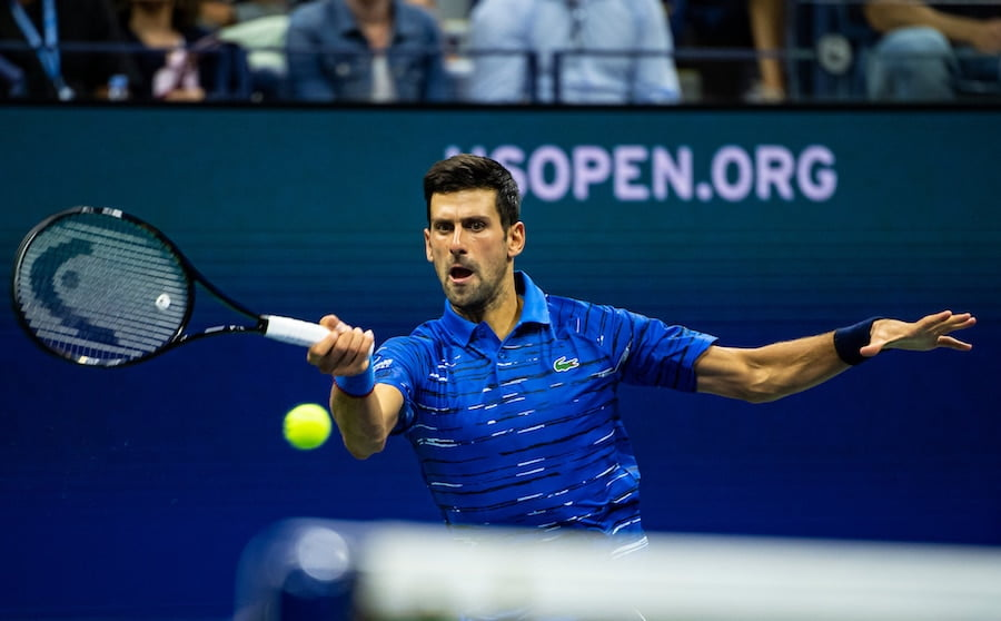 Novak Djokovic hits forehand at US Open 2019