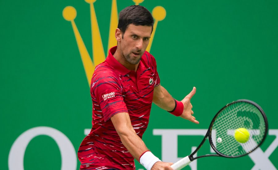 Novak Djokovic plays a backhand at the Shanghai Masters 2019