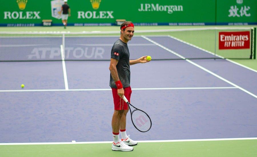 Roger Federer laughs in practise at Shanghai 2019