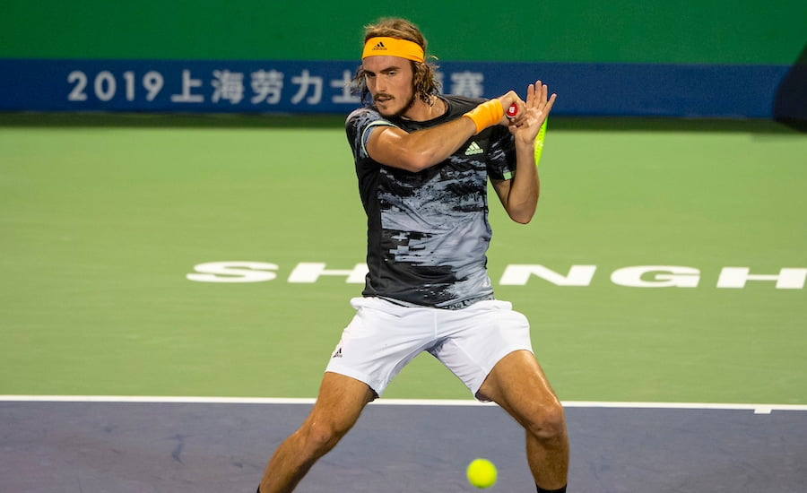Stefanos Tsitsipas concentrates on a forehand at Shanghai Masters 2019