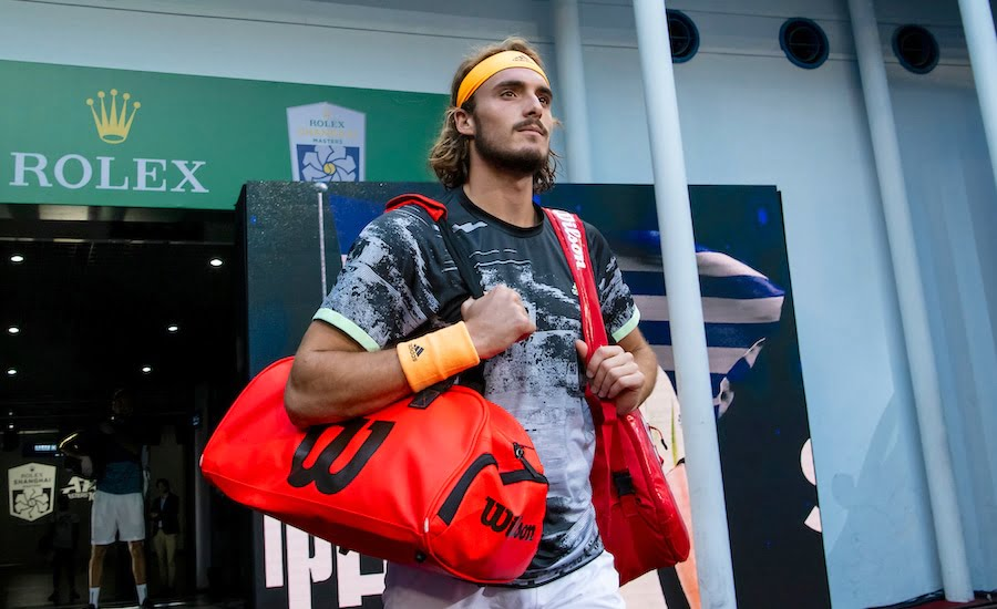 Stefanos Tsitsipas makes his way onto court at Shanghai.JPG