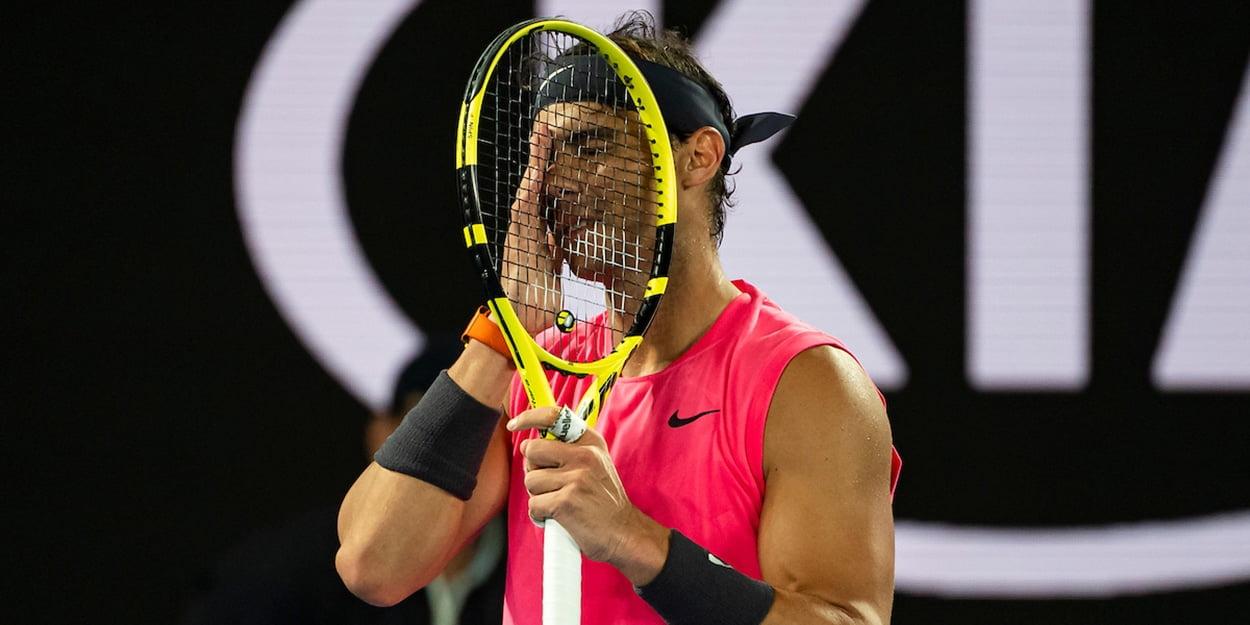 Rafael Nadal hiding behind racket
