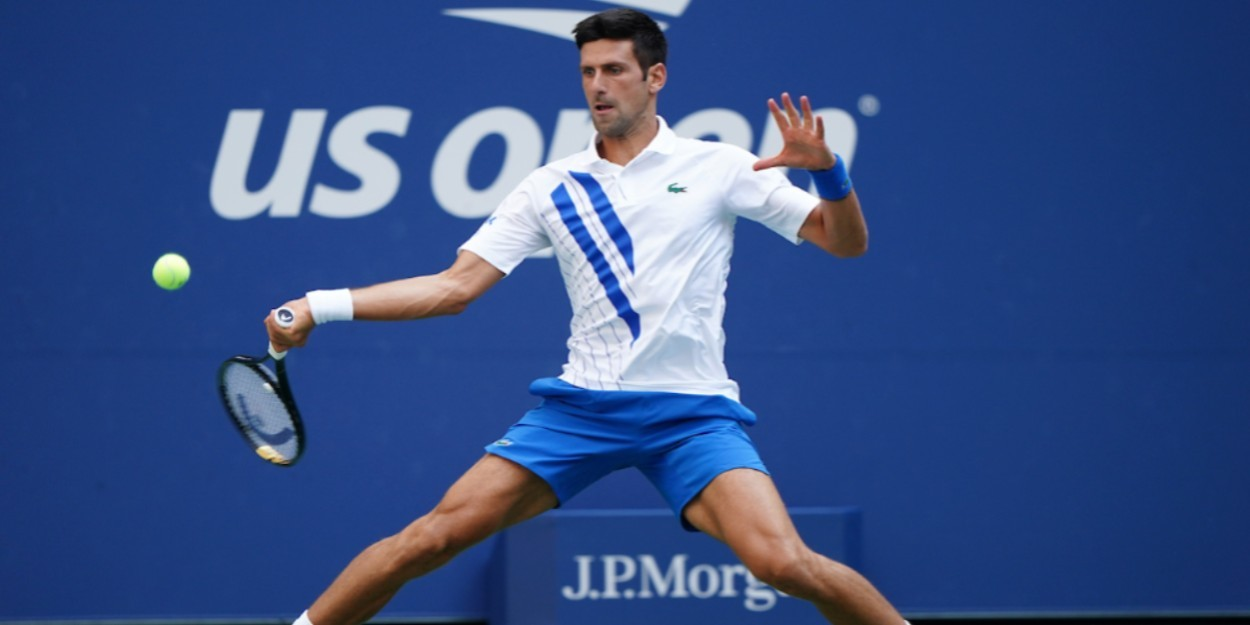 Novak Djokovic sliding