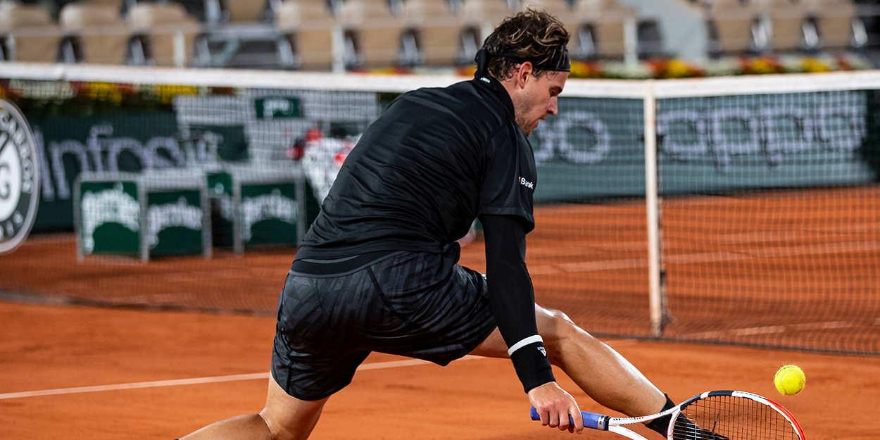 Dominic Thiem stoops at the net