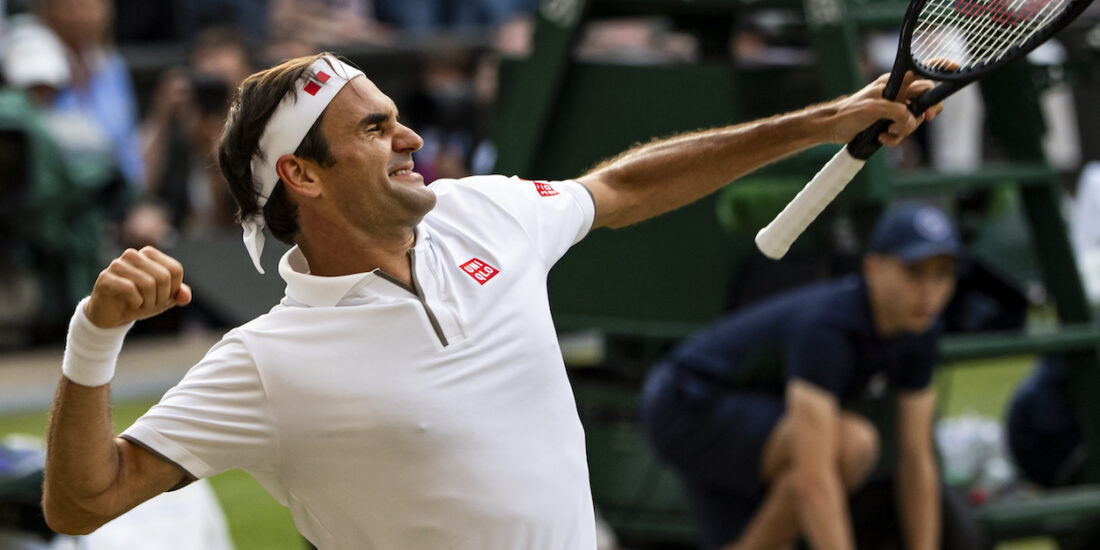 Roger Federer punches the air at Wimbledon