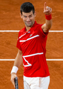 Djokovic gestures to the small crowd at the French Open