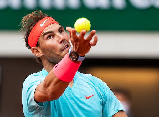 Rafa Nadal hits a serve at Roland Garros 2020