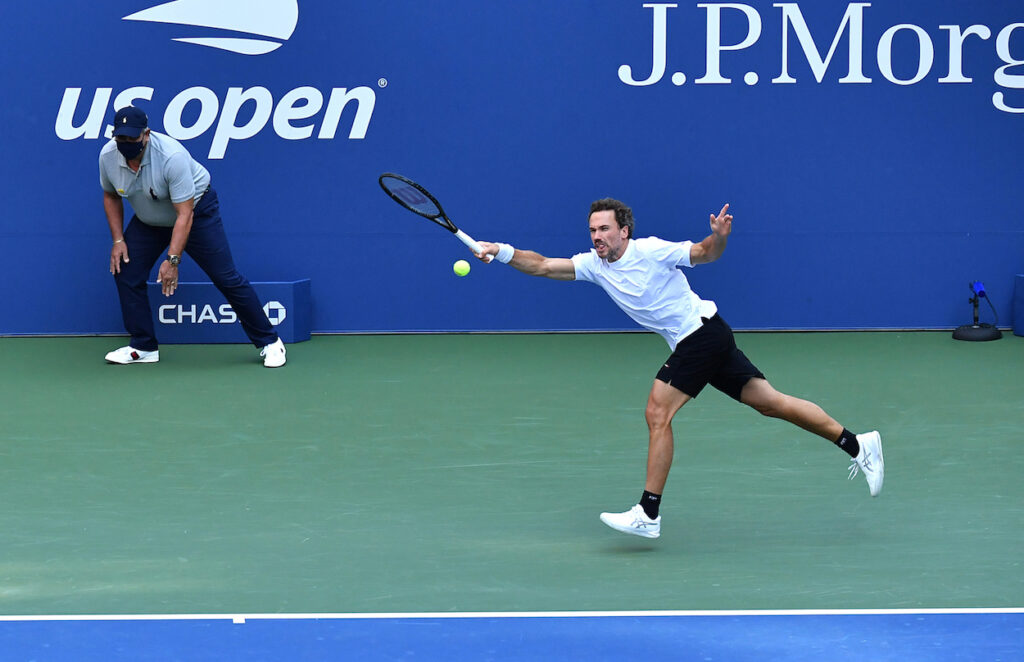 Bruno Soares stretches for a froehand return at the 2020 US Open