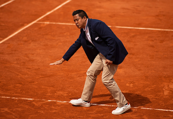 The umpire James Keothavong checks a ball mark at the French Open