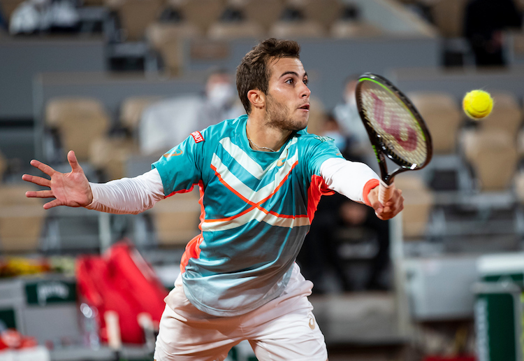 Hugo Gaston stretches for a backhand volley at Roland Garros 2020