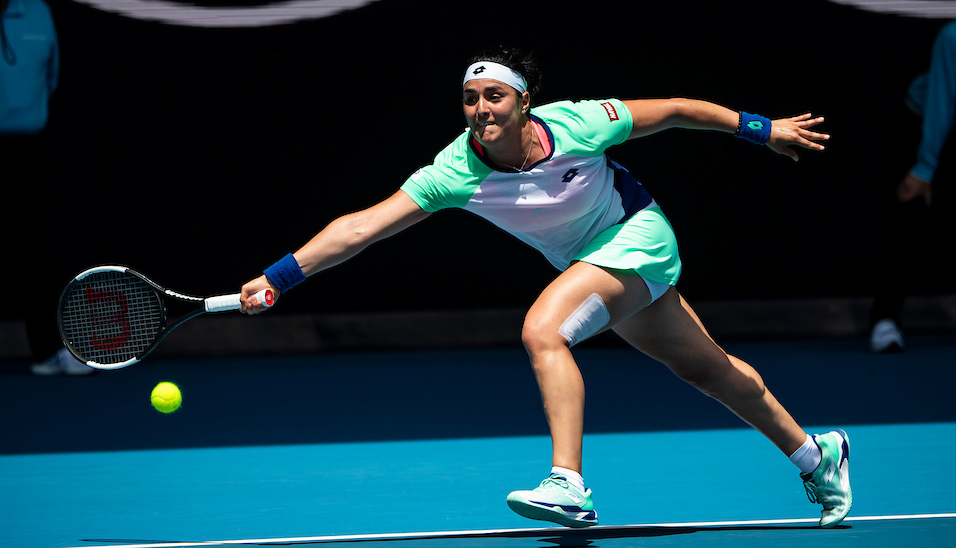 Ons Jabeur stretches for a forehand at the Australian Open 2020
