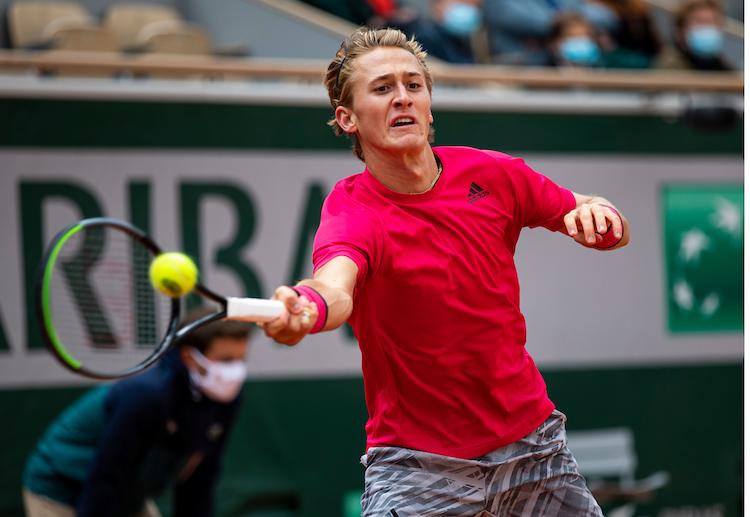 Sebastian Korda stretches for a forehand at Roland Garros 2020