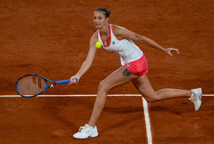 KAROLINA PLISKOVA stretches for forehand at French Open 2020