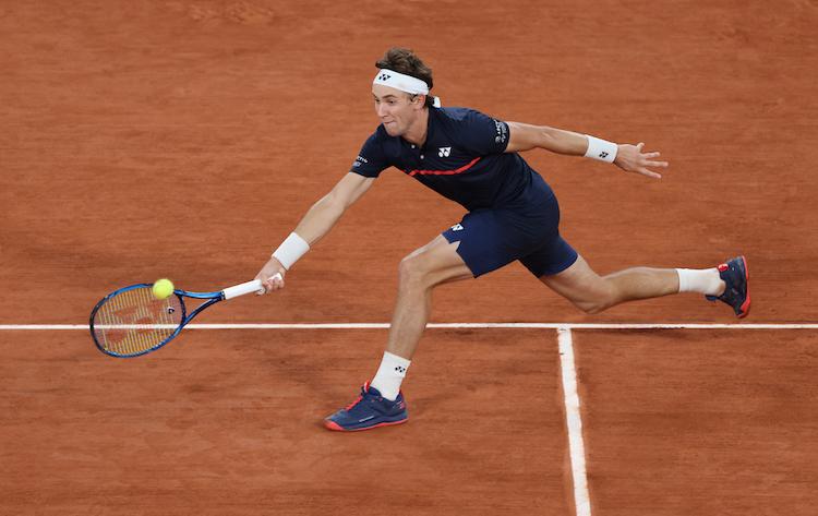 Casper Rudd stretches for a forehand at Roland Garros