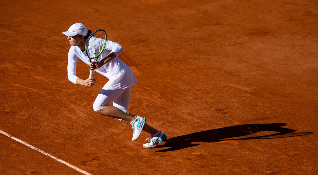 Iga Swiatek sprints for a ball during the French Open 2020