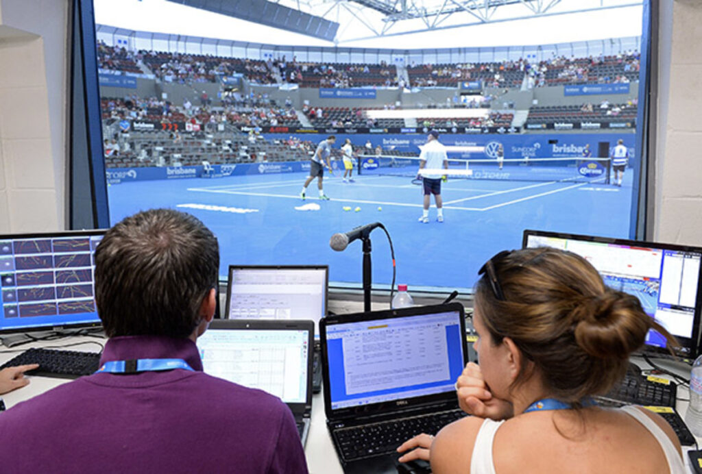 Hawk-Eye officials monitor the system from a courtside-booth