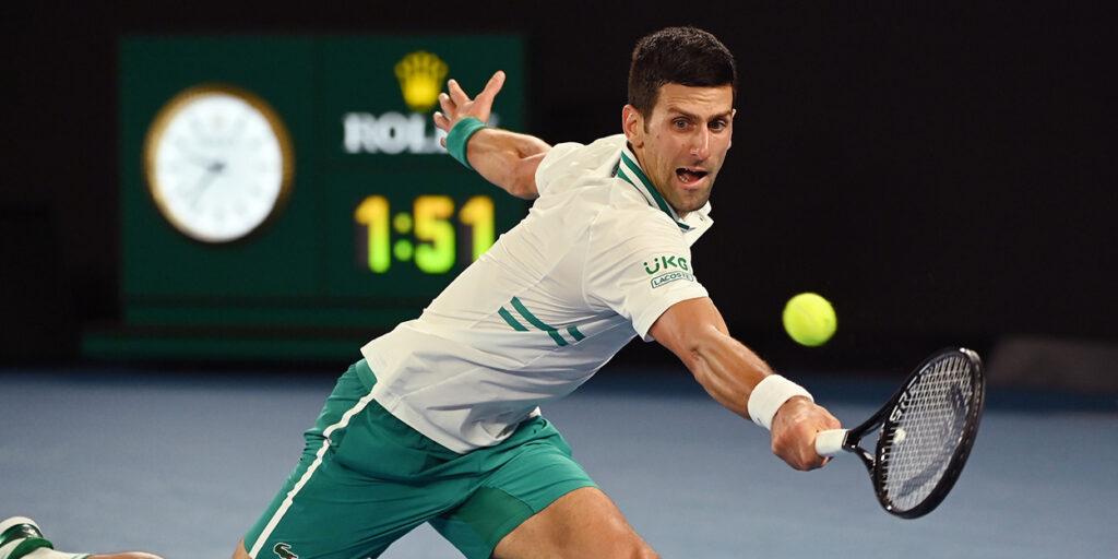 Novak Djokovic stretching for all Australian Open final