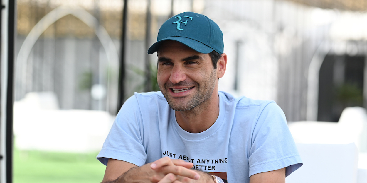 ROGER FEDERER smiles during interview