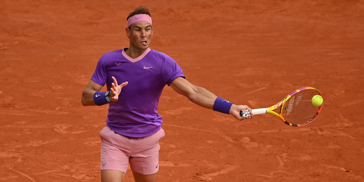 Rafa Nadal hits a forehand on clay