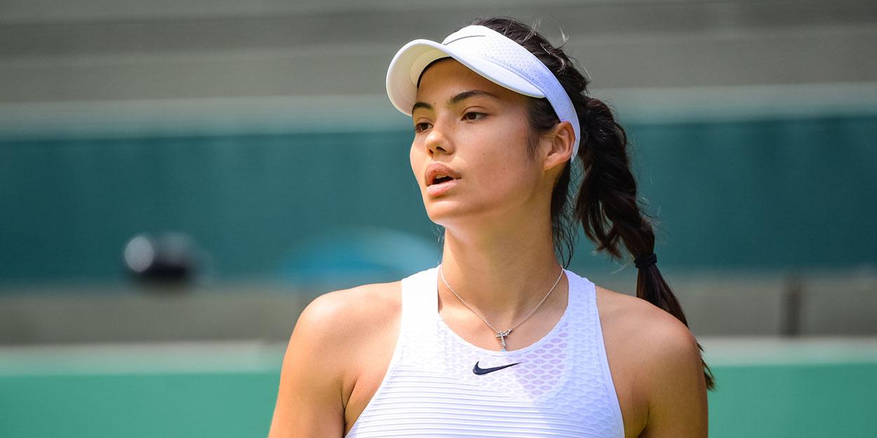 Emma Raducanu looks on at Wimbledon